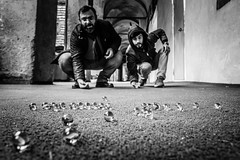 Tradesmen playing marbles in times of deadness in economy (Mustafa Selcuk) Tags: tradesman monochrome monochromatic siyahbeyaz bw bnw blackandwhite marbles 2017 eminonu fujifilm istanbul street streetphotographer streetphotography streetshooter turkey