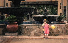 best friends (JimfromCanada) Tags: children kids discuss balloon tourist child outdoor dress cute adorable friend friends pals play talk young fun girl discussion