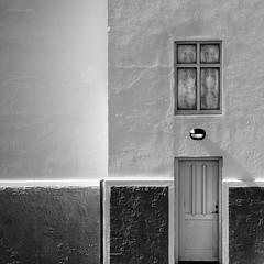 Light (Arni J.M.) Tags: door light shadow bw building window lines architecture corner iceland entrance curtains curve rectangles akranes doorlight