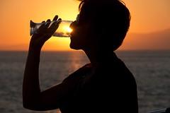 Drinking sun (ramosblancor) Tags: sunset sea portrait backlight contraluz atardecer mar holidays dusk retrato drinking greece grecia puestadesol vacaciones cyclades naxos bebiendo haveadrink cícladas tomaralgo