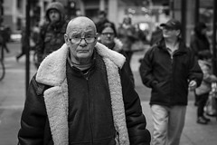 Out Of Frame (Leanne Boulton) Tags: people monochrome depthoffield urban street candid portrait portraiture streetphotography candidstreetphotography candidportrait eyecontact candideyecontact streetlife man male elderly face facial expression eyes look emotion feeling bomber jacket tone texture detail glasses bokeh natural outdoor light shade shadow city scene human life living humanity society culture canon 5d 5dmarkiii 70mm character ef2470mmf28liiusm black white blackwhite bw mono blackandwhite glasgow scotland uk