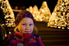 surrounded by Christmas trees (mad_airbrush) Tags: portrait emma girl face daughter tochter dark winter christmas christmastrees weihnachten weihnachtsbaum bokeh strobe strobist strobistcom flash speedlite blitz softbox yongnuo schlosswackerbarth