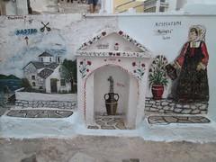 20160806_028 (a1pha_gr) Tags: ελλάδα σποράδεσ σκόπελοσ greece sporades skopelos τοιχογραφία ζωγραφική τοίχοσ βρύση γυναίκα άνθηφυτά ποτιστήρι εκκλησία γλάστρεσ mural fresco painting wall faucet woman plants flowers church pots wateringcan wateringpot