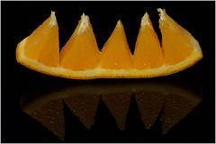 Appealing orange (markfoster999) Tags: macromondays itsapeelingtome orange onblack macro sonya77 sony bringbacktwophotos gmt closeup
