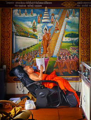 Relaxed Enlightenment (Dave_Davies) Tags: asia thailand chiangmai monastery monk buddhist relax recline enlightenment religion robes saffron chair candid