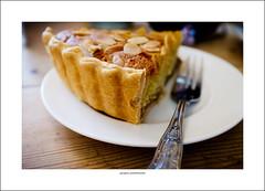 Morning sustenance (G. Postlethwaite esq.) Tags: dof fleur fujix100t staffordshire almonds beyondbokeh bokeh cafe cake cakefork depthoffield photoborder plate selectivefocus stone table tart pearandginger frangipan