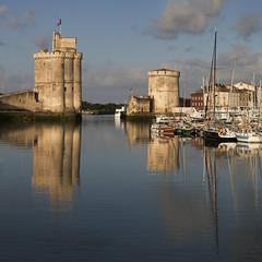La Rochelle (at sunrise) (Michel Couprie) Tags: larochelle charente france sea harbor port architecture tower town sunrise reflection reflect reflet boats canon eos ef100mmf28lismacro couprie