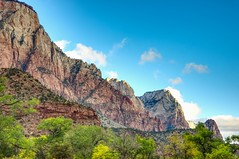 Zion National Park (Herculeus.) Tags: 2016 bouldersstonerocks clouds country cumulusclouds6kfeet day diciduoustrees erosion fall hills landscape landscapes mountains oct outdoor outdoors outside rockoutcrop rockwall stratusclouds6kfeet trees ut valley westus16 zionnp cliff crag rock rockformation ridge mountainside bluff mountain hill