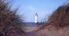 Lighthouse (chrisroach) Tags: daytrips wales countries prestatyn uk lighthouse beach dunes grass sea seaside fim scan