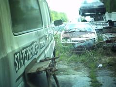 Junk Prisoner (fullcirclepiece) Tags: accord honda tiltshift georgia ga hortense car yard junk rusty old van white transport prisoner