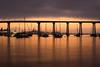Dark Sunrise In Coronado (scottdavenportphoto) Tags: boat bridge california coronado coronadobridge harbor landscape northamerica reflection silhouette structure sunrise unitedstates vehicle us