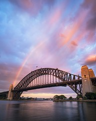A rainbow coat hanger (Jay Daley) Tags: sunrise clouds storm rainbow harbourbridge australia sydney