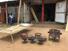 Maaji refugee settlement - Selling cookstoves at the market (FAO Forestry) Tags: fao un uganda refugees unhcr world bank environment energy south sudan woodfuel forestry