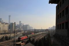 I_B_IMG_8343 (florian_grupp) Tags: asia china locomotive train railway railroad passenger diesel electric beijing station citywall beijingmainstation chaoyang peking cnr chinanationalrailway traffic bluesky