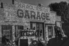 Garage Decay (Tim @ Photovisions) Tags: abandoned garage station wrecker truck nebraska metal junk monochrome blackandwhite