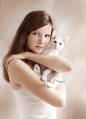 The girl with a white kitten (MihailovOleg) Tags: cat animal cornishrex portrait cute pet kitty stare gaze adorable feline fur domestic young kitten beautiful soft puss furry pretty loving household charming grooming suspicion interested inquisitive mammal compassion shorthair cuddly white bride face female girl hand lady pale person pose purity woman hold holding dream dreams blue