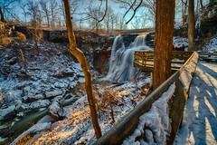 Framing the Falls (tquist24) Tags: brandywinecreek brandywinegorge cuyahogavalleynationalpark hdr nikon nikond5300 ohio cold creek fence geotagged gorge ice light longexposure morning park river rock rocks shadow shadows sky snow stream tree trees water waterfall winter northfield unitedstates brandywinefalls people