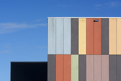 Building with colored panels (Jan van der Wolf) Tags: 173205v panels facade gevel architecture architectuur building school geometric geometry geometrisch geometrie