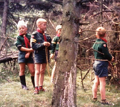Hiding in the woods (theirhistory) Tags: children boys kids tree wood forest cubs shorts jumper shoes wellies rubberboots branches