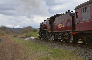 LMS Crab Locomotive No.13065 departing from Burrs with the 14.50 Bury to Rawtenstall service. Peel Tower can be seen on the distant hill. East Lancs Railway. 01 04 2018
