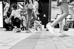 Dragged along (gergelytakacs) Tags: asia china chinese eastasia fareast hk hongkong hongkonger pearlriverestuary sar bw black blackandwhite boy bystander calle candid child city direction documentary flâneur harbor kid leg legs mom monochrome mother otherway pavement pedestrian photo photography port public purse rue shoes sidewalk space strada stranger strasenfotografie street streetphotographer streetphotography streetphotgrapher streetphotgraphy streetphoto streets streetscape stroll tile toddler ulica unposed urban urbanphoto urbanphotographer urbanphotography utcafotó walk walker walking white улица רחוב 香港