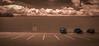Parked Cars (veyoung52) Tags: cars parking parkinglot shoppingcenter audubon newjersey clouds sepia toned
