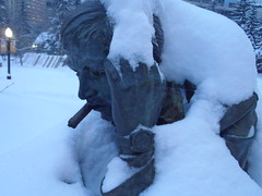 Waiting for Spring .... (Mr. Happy Face - Peace :)) Tags: yyc cowtown alberta canada citycenter snow spring art2018 weather glow archives cigar watch hand face stranger eyes guy man sculpture chill cool bench thinking pose headache thinker contemplation waiting