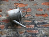 Hanging Around (manxmaid2000) Tags: watering can nail wall old worn brick decay texture garden tool
