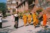 Monks (D. R. Hill Photography) Tags: thailand monks orangerobes buddhist buddhism buddha tourist asia southeastasia yashica yashicaelectro yashicaelectro35mc 40mm primelens fixedfocallength film analog 135 35mmfilm agfa agfaphotovistaplus200 agfavista agfavista200 vista street streetphotography yashinon
