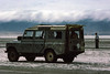 Landrover in Ngorongoro Crater, 1975 (NettyA) Tags: 1975 35mm africa africanoverlandtrip kodachrome konicat3 landrover ngorongorocrater tanzania clouds saltpan scannedslide slidefilm