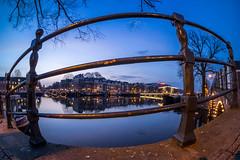Fenced (rpajrpaj) Tags: magerebrug canal city cityscape bluehour amstel carre samyang fisheye 75mm samyangcsc75mmf35umcfisheyemft thebluehour