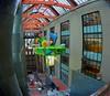 Dreams Aloft (MPnormaleye) Tags: library courtyard atrium fisheye distorted dreamy lensbaby architecture utata sculpture escalator shelves