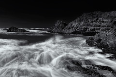 Here come the waves! (Masako Metz) Tags: beach rocks waves ocean sea sand seaweed water oregon coast pacific northwest usa america nature landscape seascape waterscape outdoor motion movement blackandwhite monochrome incoming