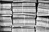 Spines (Sean Batten) Tags: london england uk blackandwhite bw papers newspaper unitedkingdom gb nikon df 35mm bundle charingcross city urban