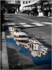 The Puddle Perspective (kurtwolf303) Tags: spanien spain puddle pfütze street strase reflection spiegelung perspective water wasser buildings gebäude olympusem1 omd microfourthirds micro43 mft kurtwolf303 systemcamera mirrorlesscamera spiegellos unlimitedphotos urban moraira costablanca