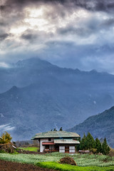 Bhutan: Farmhouse in Gasa Valley. (icarium.imagery) Tags: bhutan travel canoneos5dmarkiv architecture bluehour captureone clouds dramaticsky drukyul forest gasavalley himalayas layers mountainrange mountains mysterious mystical peaks rural sigma50mmf14dghmsart leefilters farmhouse
