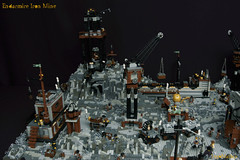 03_Endarmire_Iron_Mine (LegoMathijs) Tags: lego moc legomathijs steampunk mine miners mining rocks iron ore steampowered drones tracked driller flying discovery vehicle explorer speeder transporter transport airship clockwork drone speeders walking steamcopters pickaxe tools crates shaft cranes workshop gears cave docks