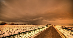 The road into Darkness. (Alex-de-Haas) Tags: 11mm aurorahdr d750 dutch hdr holland irix nederland nederlands netherlands nikon noordholland photomatix westfrisia westfriesland art artistic artistiek beautiful betoverend bevroren boerenland cloud clouds cold daglicht daylight desolate farmland fire flat frozen heaven hemel kou kunst landscape landschap licht light lucht mooi plat polder skies sky sneeuw snow sunrise verlaten vuur water winter wolk wolken wonderful zonsopgang