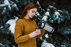 Daria Gladchenkova (ivan_volchek) Tags: winter cold people outdoors nature snow portrait leisure beautiful season girl lifestyle wear fun thermos cup pullover firtree tree
