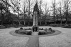 at the cenotaph (while doggy life continues in the background) (louys:) Tags: dogs cenotaph dunblane landscape street fuji xt2 xf18mmf2r primelens wideangle blackandwhite monotone monochrome bw memorial