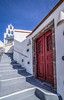 In the village (Vagelis Pikoulas) Tags: pyrgos santorini thira cyclades kyklades island islands greece sky blue winter january 2018 door red white beautiful tokina 1628mm landscape village villagescape town canon 6d