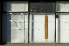 suspended 18 (godelieve b) Tags: brussels bruxelles suspended ensuspens fenêtre window shop abandonned abandonné lines street urban noncoloursincolour white sticky papiercollant tape