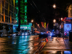 mission at 22nd street (pbo31) Tags: sanfrancisco california nikon d810 color night black lightstream traffic city urban march 2018 boury pbo31 rain wet missionstreet mission reflection theater neon sign cinema muni bus motionblur