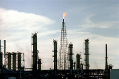 1a-441 (ndpa / s. lundeen, archivist) Tags: nick dewolf nickdewolf photographbynickdewolf 1978 1970s color 35mm film 1a reel1a louisiana southernlouisiana neworleans refinery oilrefinery smokestack smokestacks smoke derrick fire flame