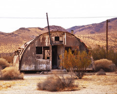 """as-is"" condition (Maureen Bond) Tags: ca maureenbond mojave desert hot dry quiet empty bunker creepy wicked oncewas fenced off wires fencedoff quonset"