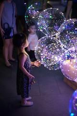 So pretty (ah.b|ack) Tags: sony a7ii a7mk2 zeisscsonnart1550mmzm wideopen ilight marina bay singapore kids balloon pretty lights