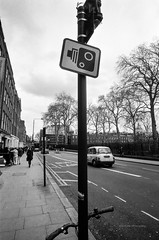 From London | Photography by The Man (MR Photog) Tags: leicam2 leitz superangulon 21mm schneider kreuznach agfa100 pushed asa200 bw blackandwhite film analog public camera street cctv surveillance monitoring traffic london city urban necessaryevil sign notice