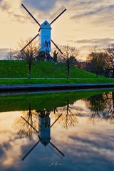 Windmill in Bruges. (Jochem.Herremans) Tags: fiets stad brugge fietstocht natuur camperen travel famous vacation beautiful sky agriculture background building city view green belgium wooden power europe grass traditional mill wind heritage evening path lights old canal flemish river nature windmills vintage blue architecture white town belgian landmark bruges attraction outdoor holiday scenic flanders windmill romantic european landscape