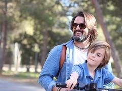 Uncle and nephew (AriCatalán) Tags: bokeh niño moto kid bike