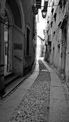 The way home (little_frank) Tags: viabossi ortasangiulio piedmont italy blackandwhite bw blackwhite street italia vicolo strada biancoenero alley lane citycentre old ancient past walking exploring walls way city architecture provinciadinovara